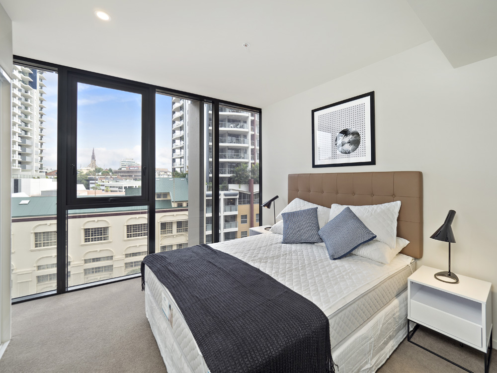 Real estate apartment photography Spire Residences, Apartment 609 Bedroom, July 2018