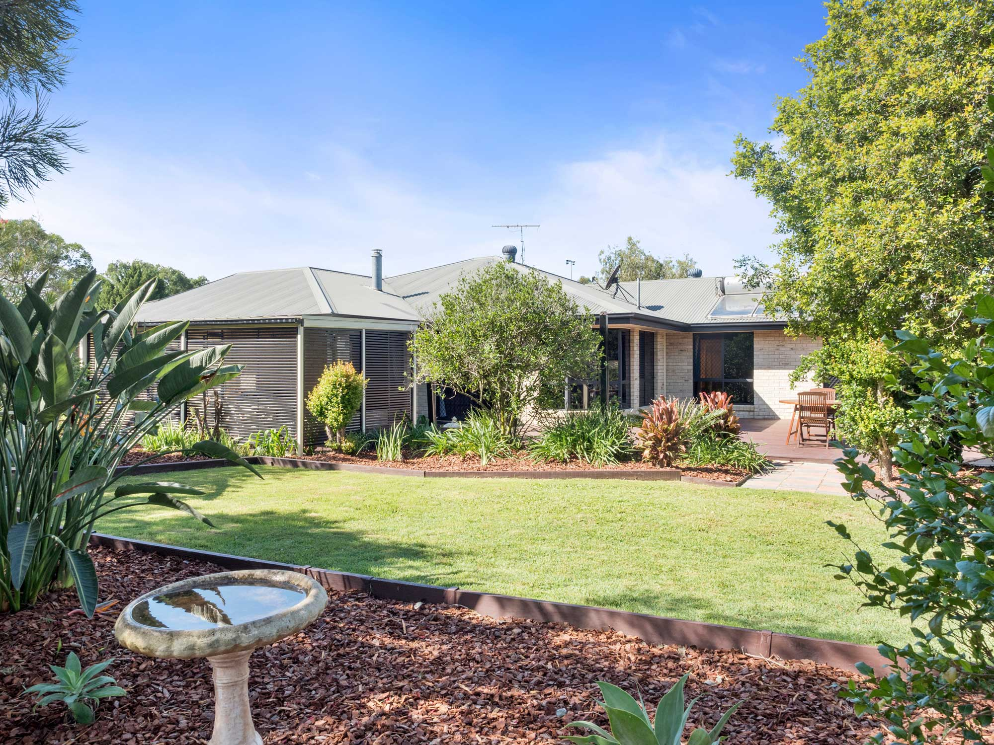 Beautiful gardens greet the home owner at 33 Shergar Court Jimboomba