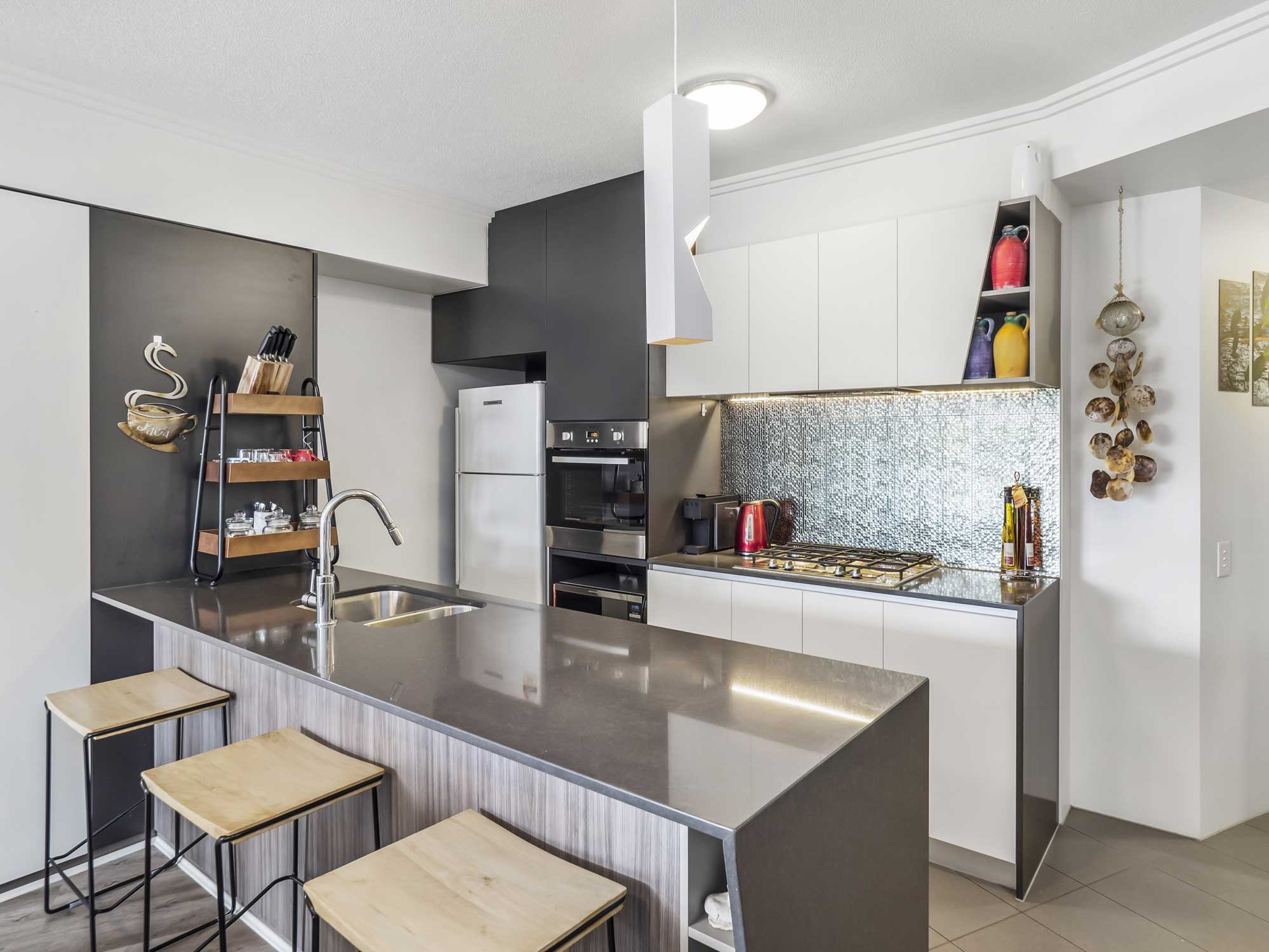 Real estate photography of Kangaroo Point apartment for sale - the kitchen