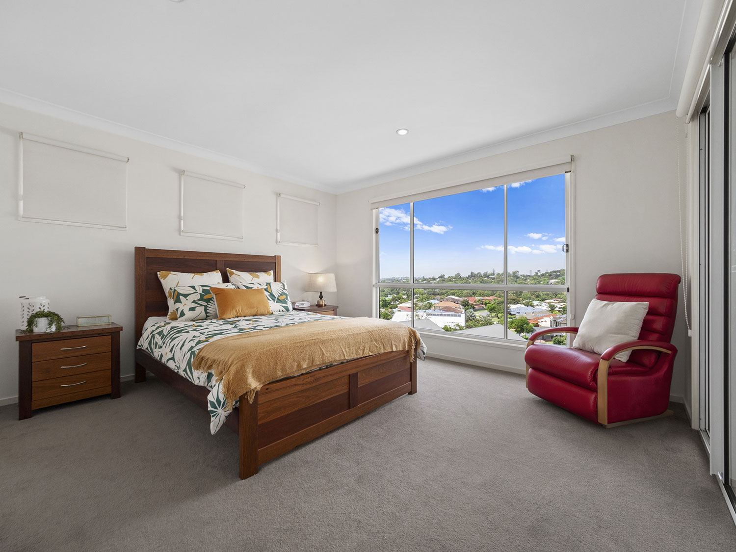 Capturing the master bedroom of the home for sale at Mitchelton