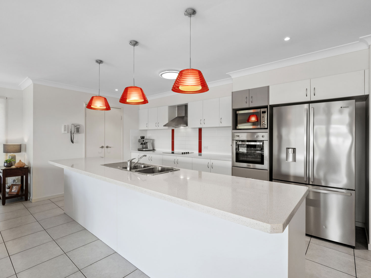 Capturing the kitchen area of the home for sale at Mitchelton